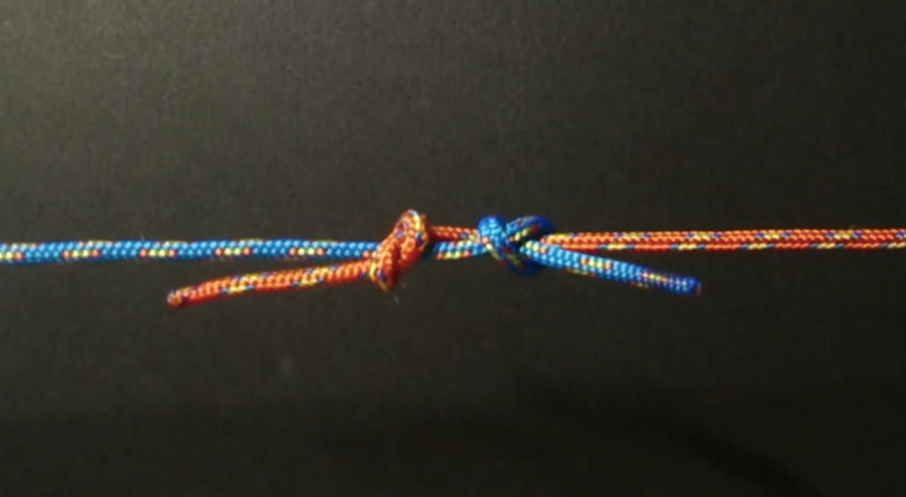Fishermans knot made from blue and red cord