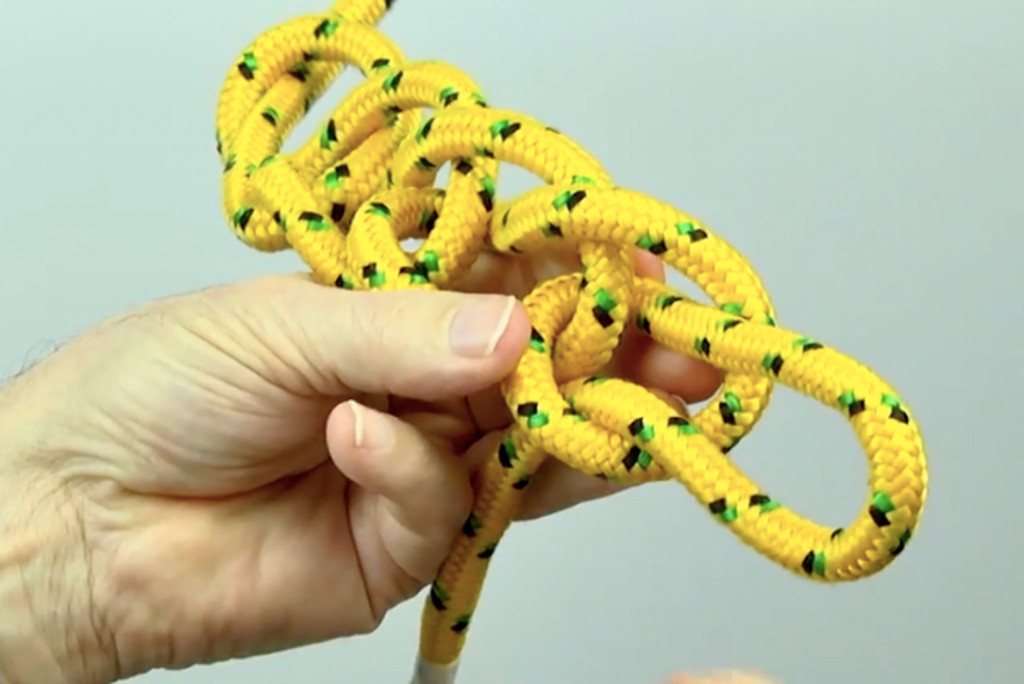 Chain sinnet knot made with yellow cord